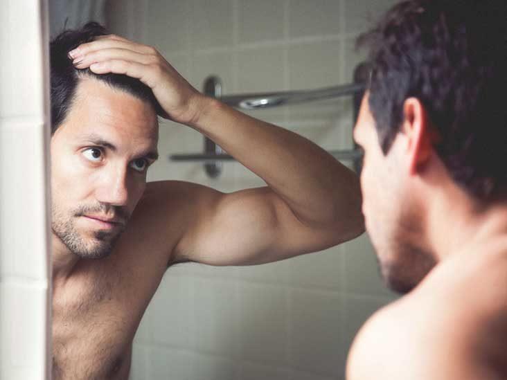 guy in mirror hair